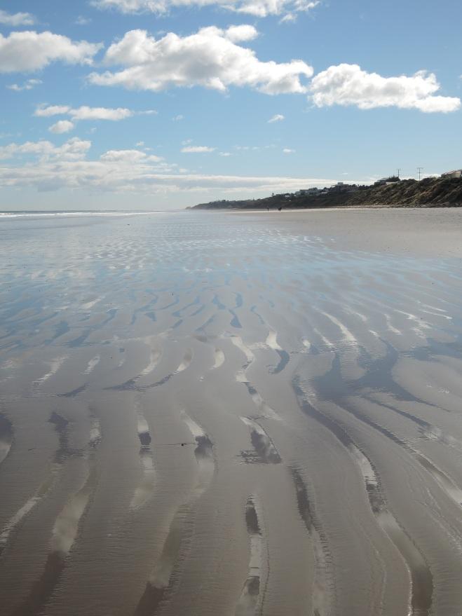 Sky, sea and rippling sand