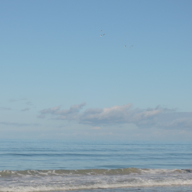... solid blue running toward an indistinct horizon ...